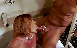 Mandy Mayhem taking huge white cock in the hot tub